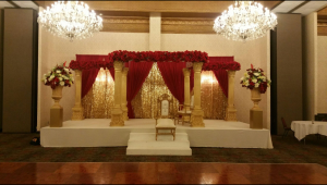 Red with Gold Sequin, 8 Columns, and Silk Flowers Backdrop