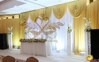 White and Gold Backdrop with Gold Swag
