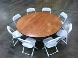 Set of 60\' Round Table and 8 Brown Chairs