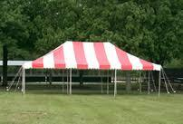 20\' x 30\' Pole Tent White / Red Stripes  Customer Set Up  (Tools Not Included) Staked in the ground